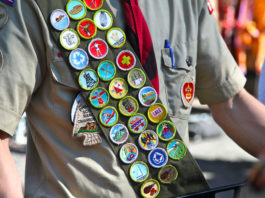 Boy Scouts are receiving a guide outlining how to put condoms on their scout leaders