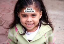 """Don't Molest Me"" Sticker on Child's Head"