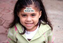 """Don't Molest Me"" Sticker on Child's Head"